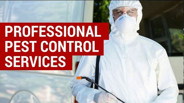 pest control expert wearing protective white overalls